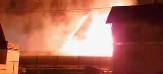 Güterwaggons mit Spraydosen in Flammen - Großeinsatz am Rhein