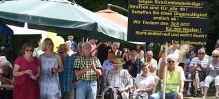 Kommentare und Buh-Rufe: Protest gegen Anliegerbeiträge